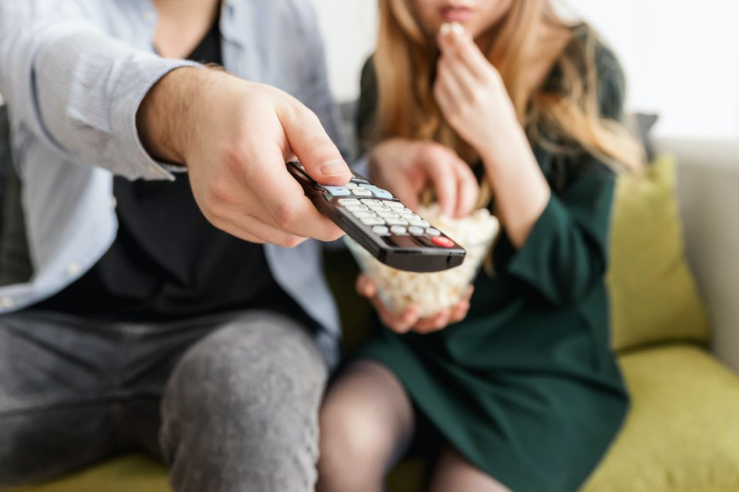 Man Holding Remote Control 1040160