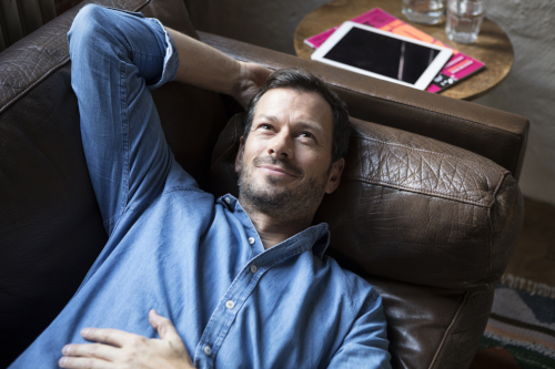 Man Lying On Couch, Daydreaming